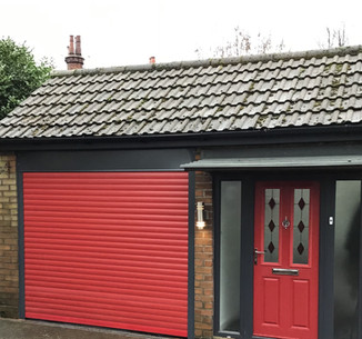Domestic insulated roller shutter in red.