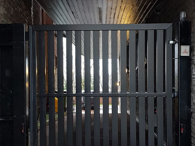 Automatic swing gate replacement for an