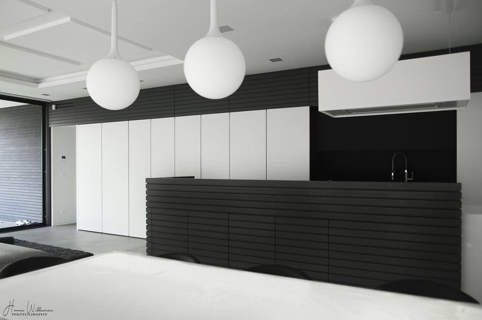 BEN woning sierpleister voorgespannen welfsels zonwering oversteek jaloezien aluminium ramen silicaatsteen modernisme