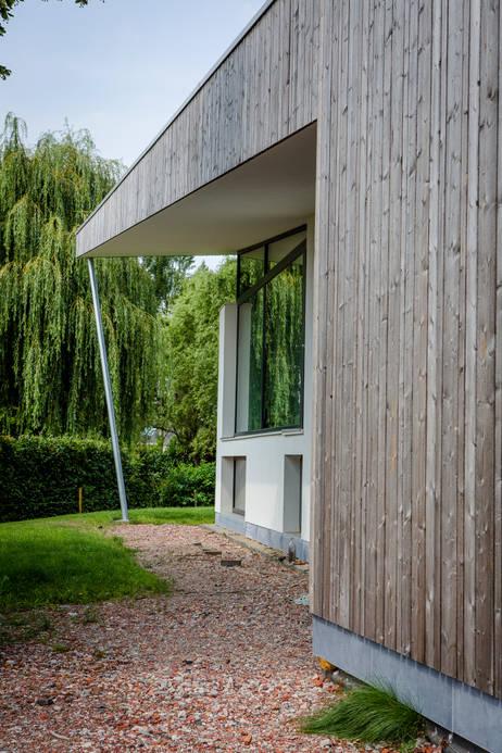 passieve woning passief huis bepleistering thermowood vliesgevel oversteek kolom split-level