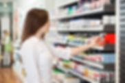 girl filling prescription at pharmacy