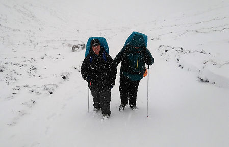 Blind lady walking  in the winter mountains