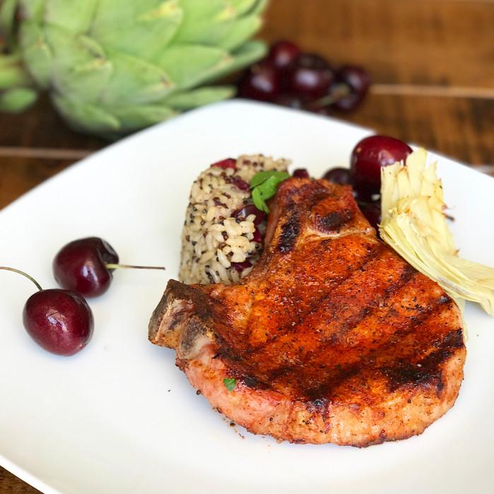 Blackened Pork Chops served with Cherry-Artichoke Brown Rice