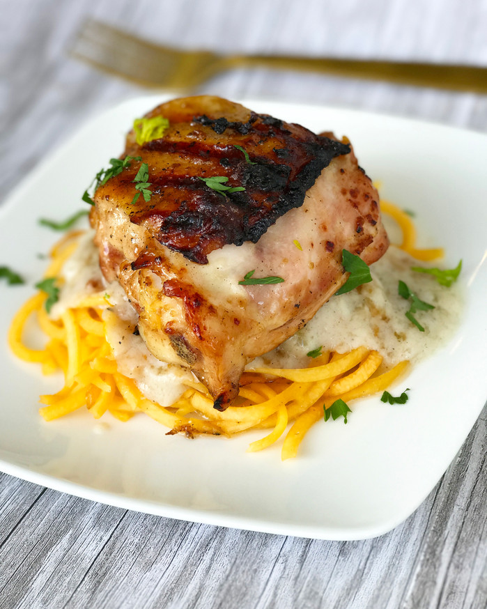 Smoked chicken thighs with spiraled sweet potato and coconut cream sauce