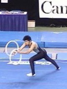 A rhythmic gymnast gymnast about to throw the double rings to do a risk.