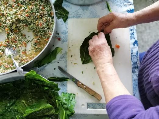 Granny preparing stuffed cabbage leaves