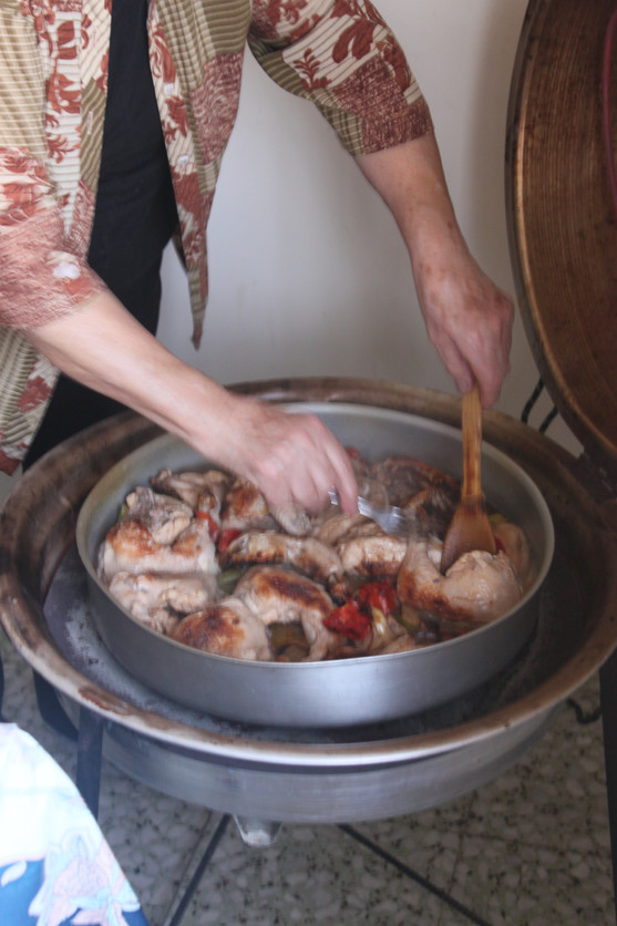 Granny cooking chicken