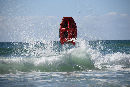 Australian surf rescue robot jumping over a wave