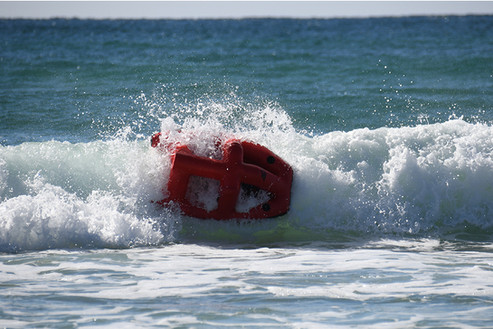 Australian surf rescue robot tumbling in the wave