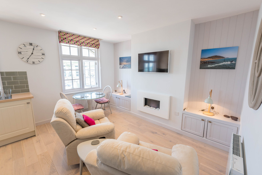 Living room/dining area at By the Harbour apartment, West Bay self catering, Dorset