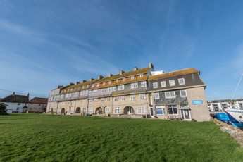 Pier Terrace from the shared lawn at By the Harbour apartment, West Bay, Dorset
