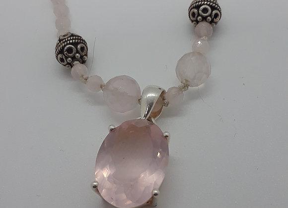 Rose quartz pendant on silk knotted necklace