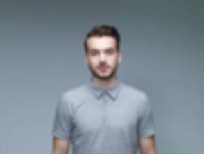 Headshot of Man Wearing a Grey Shirt