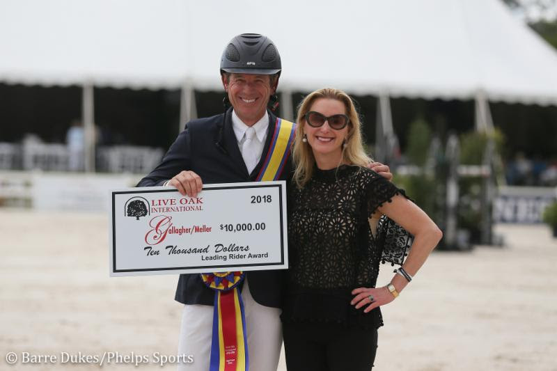 BEAT MANDLI PROUDLY HOLDING HIS CHECK FOR THE LEADING RIDER AWARD WITH JULIET REID.