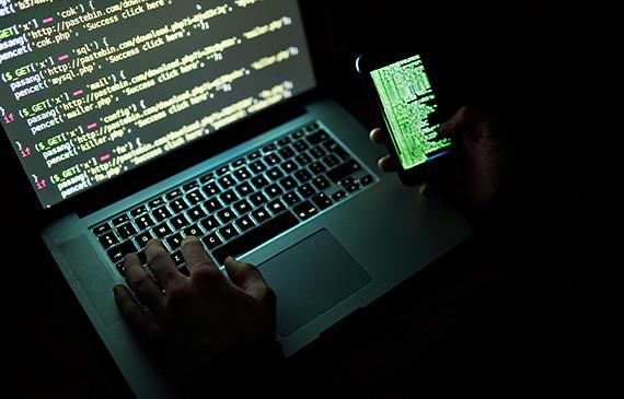 Hacker committing fraud.