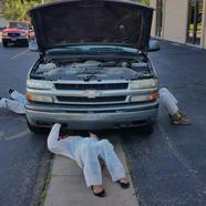 Students learning basic vehicle maintenance