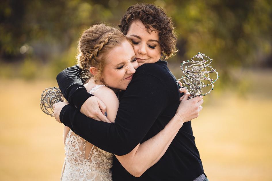 Bride and Bridesmaid Share a Hug