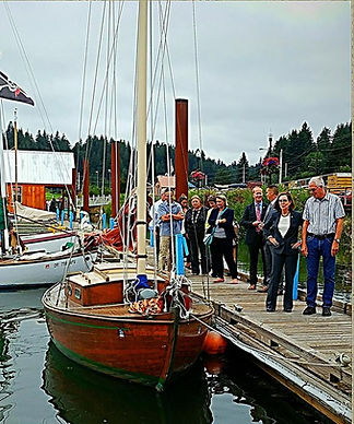 Port manager Bud Shoemake introducing Gov. Kate Brown to the Teak Lady sailboats.