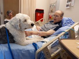 Butler visiting Pat in the hospital