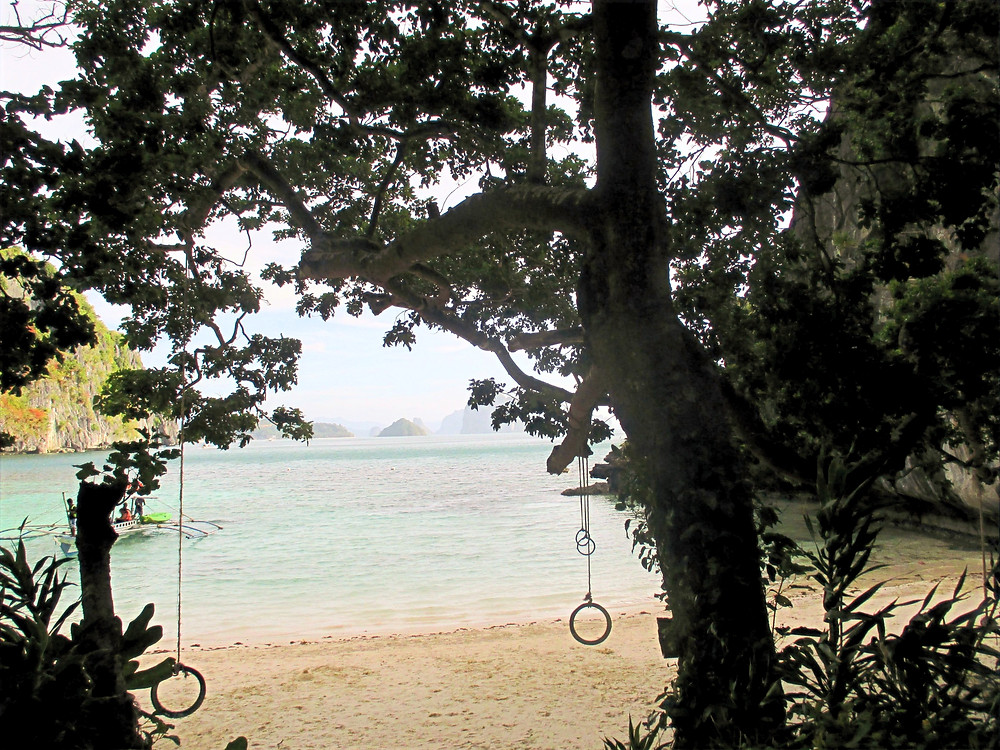 Swings on the beautiful and peaceful Commando beach- one of the pit stops during Island Hopping tours