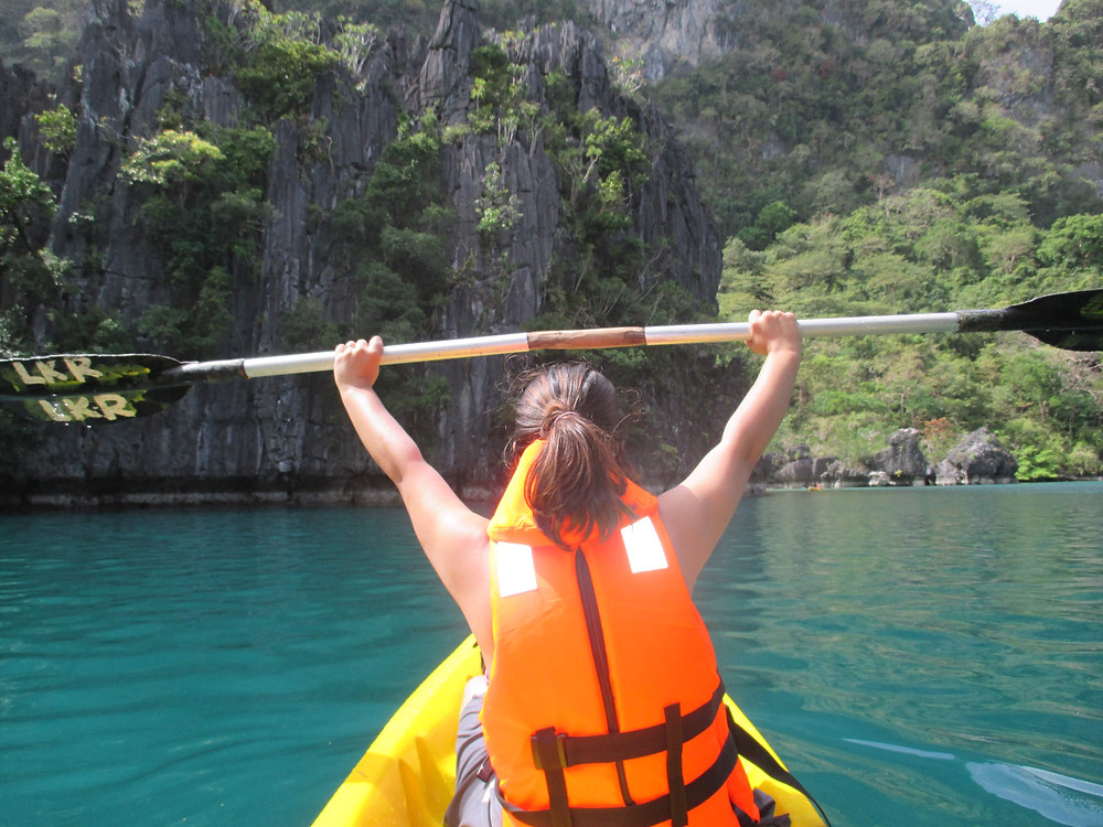 Woman kayaking in the Big Lagoon at El Nido