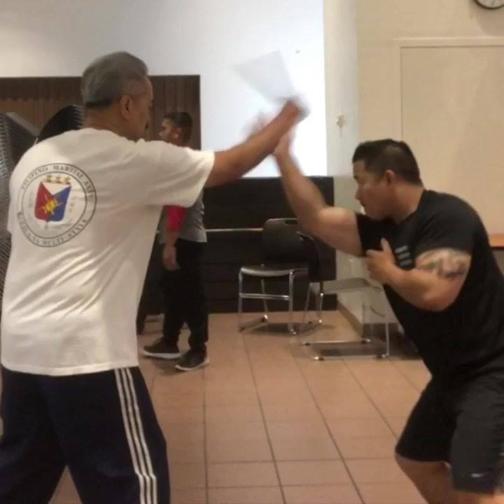 "BNMS Instructors June Gotico and Edward Talisayan practicing a basic "" Follow"" Parry Drill."