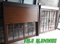 Colonial con cortina de aluminio