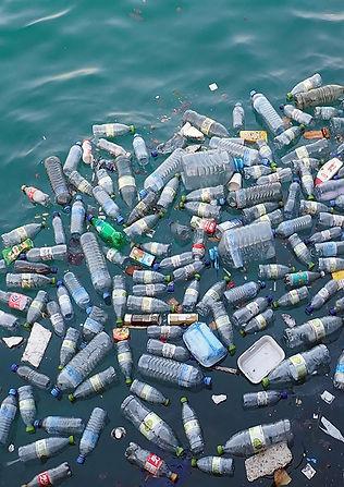 Garment Pollution - Bottles on th sea