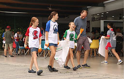 Cleanup with kids wearing custom apparel