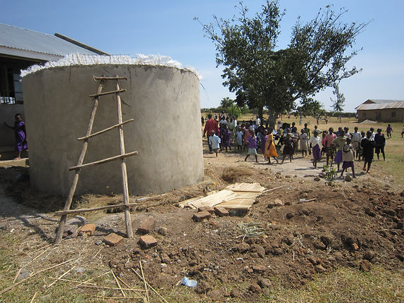 Rainwater harvesting tank constructed by Progressive Health Partnership in southwestern Uganda