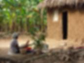 Woman winnowing ground nuts in Progressive Health Partnership's partner community of Kashongi, Uganda