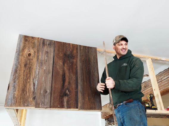 Kevin creating a rustic accent wall.