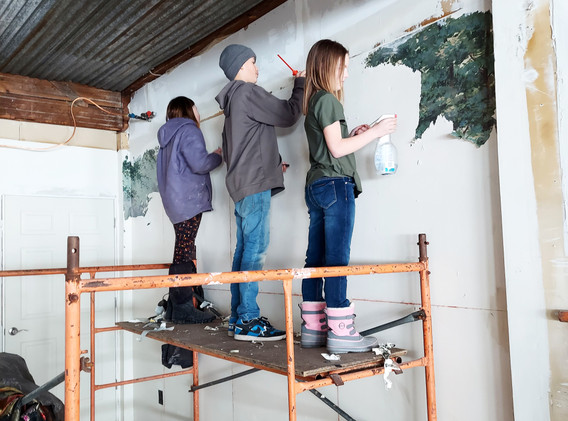 The wallpaper mural that was here did not match the theme.  These helpers took care of the removal of the wallpaper.