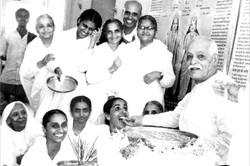 BaapDada giving Toli after Murli