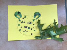Leopard made of leaves and paper