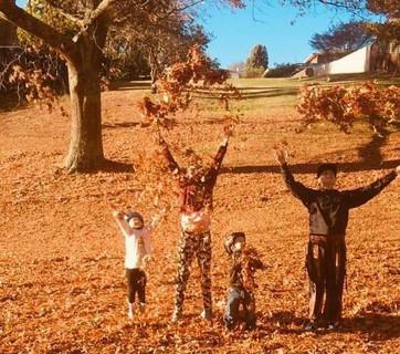 Children throwing leaves