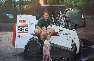 Greg Berres of Blue Dot Services with kids