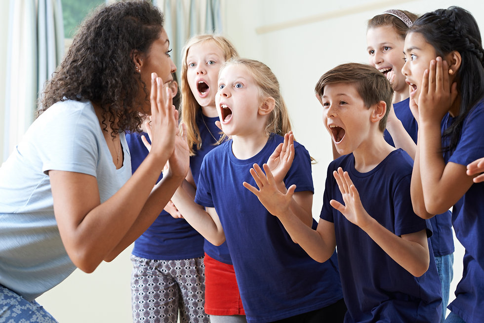 A group of middle school children filled with happiness while taking part in an adult-facilitated Drama Lab summer camp.