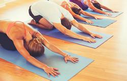 bigstock-Yoga-Class-Group-of-People-Re-99566111