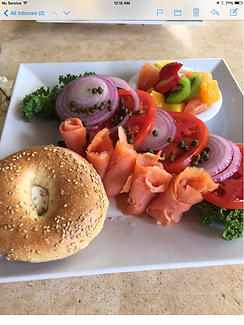 Eggscetera cafe lox platter with onions, cappers, tomato and bagel