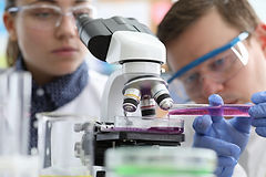 bigstock-Male-And-Female-Chemist-Resear-