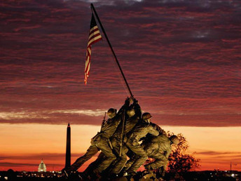 The early morning sun begins to rise behind the Iwo Jima Memorial on November 11, 2004 in Arlington,