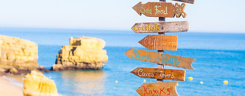 Sign with list of attractions on Praia d
