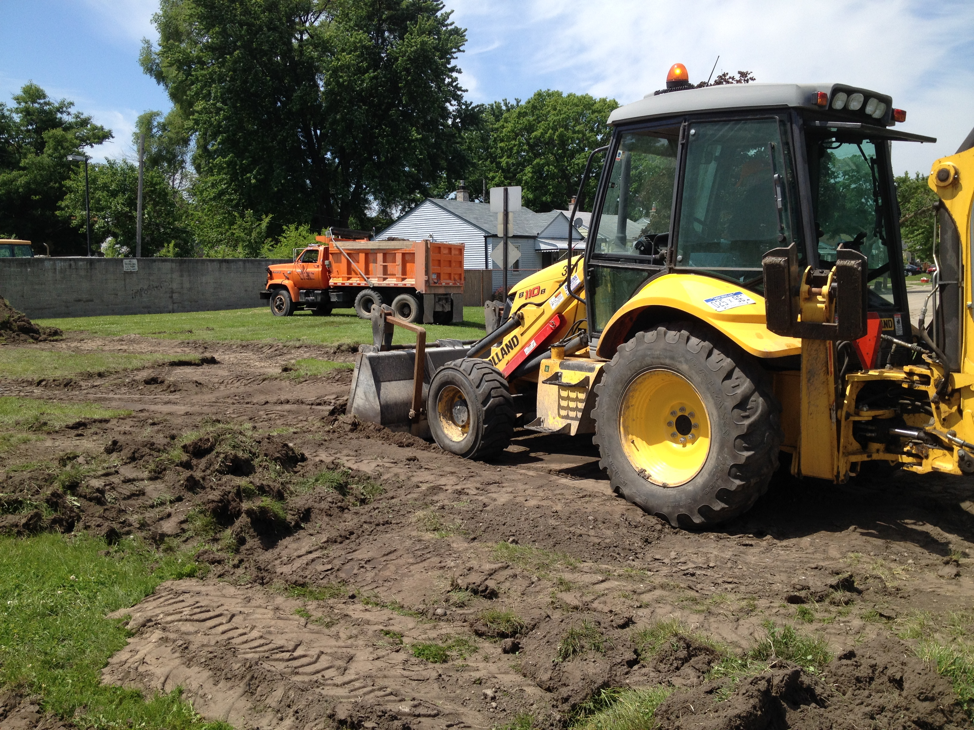 Tearing up grass for Parking Lot!