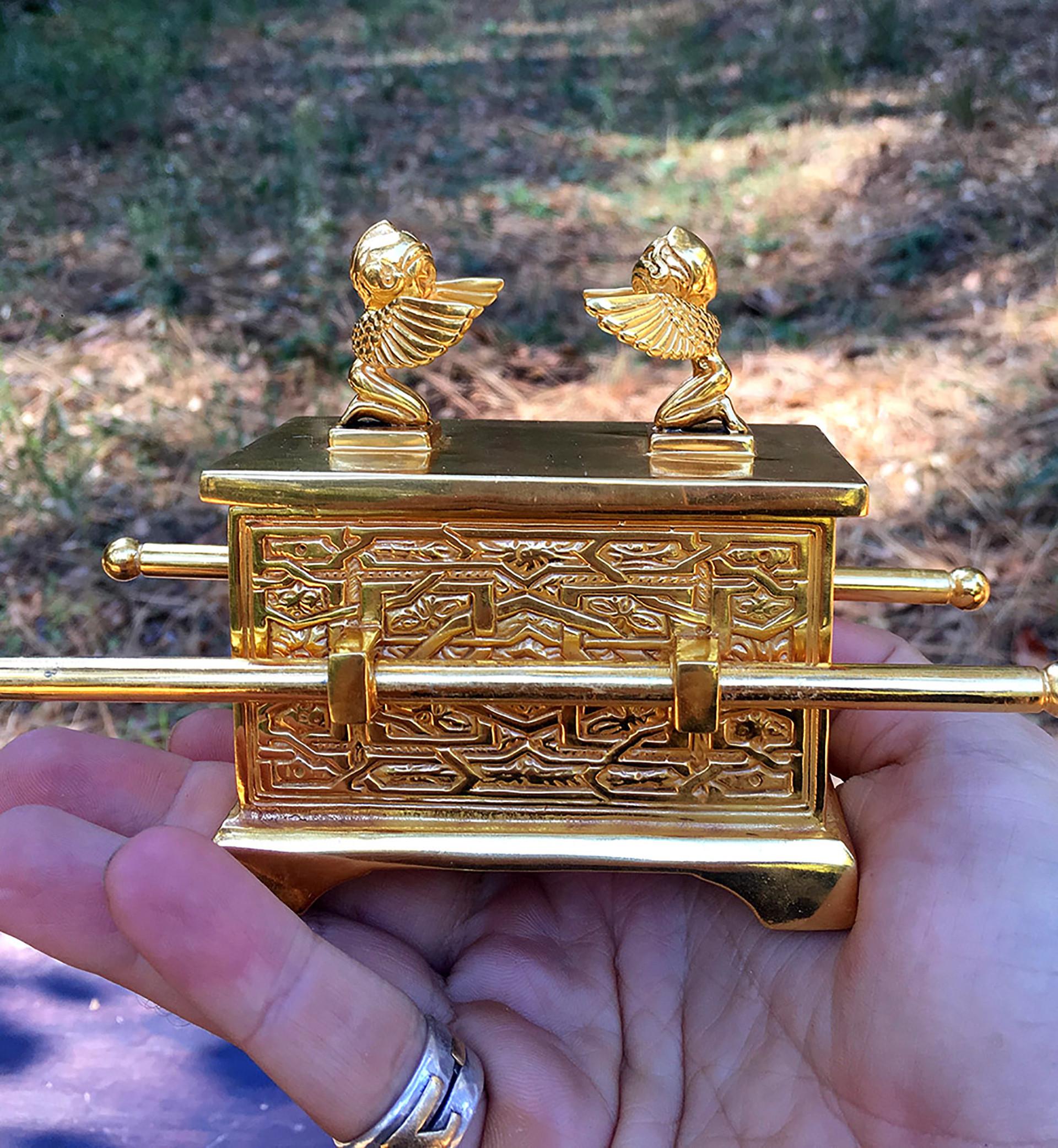 ARK GOLD IN HAND.jpg