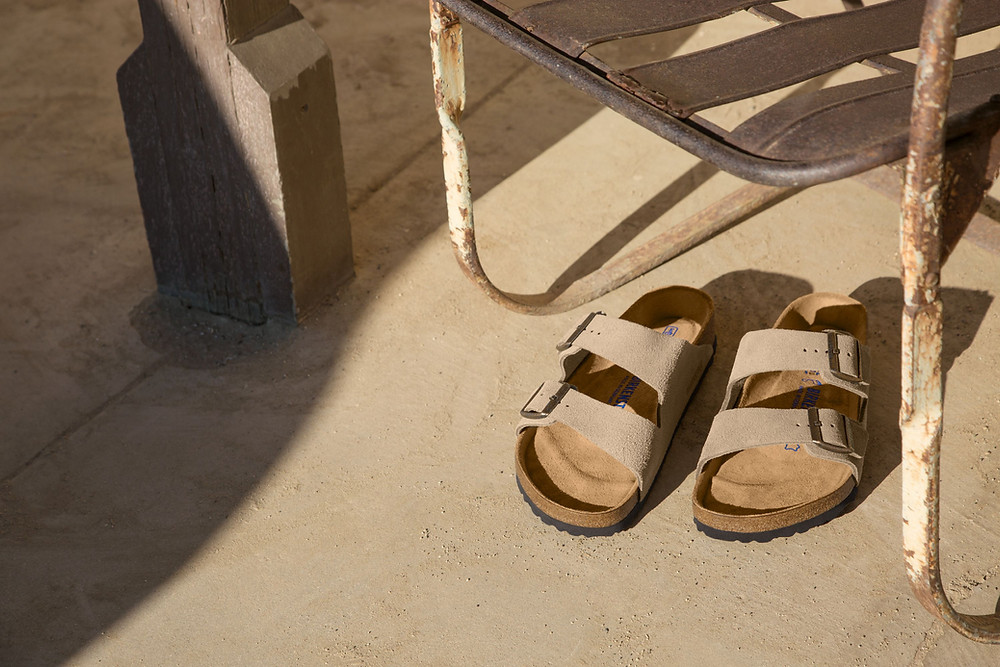 Birkenstock Arizona Taupe under wooden table
