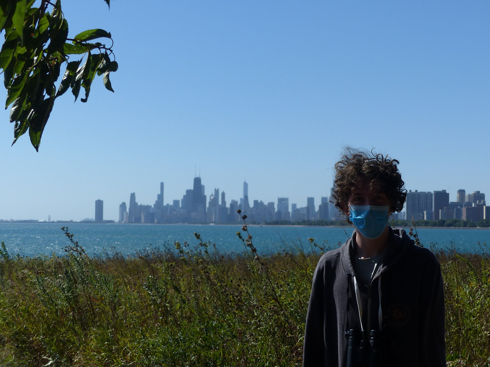 Thomas with the Chicago skyline in the background