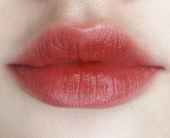 Rose coloured stained lips on white female