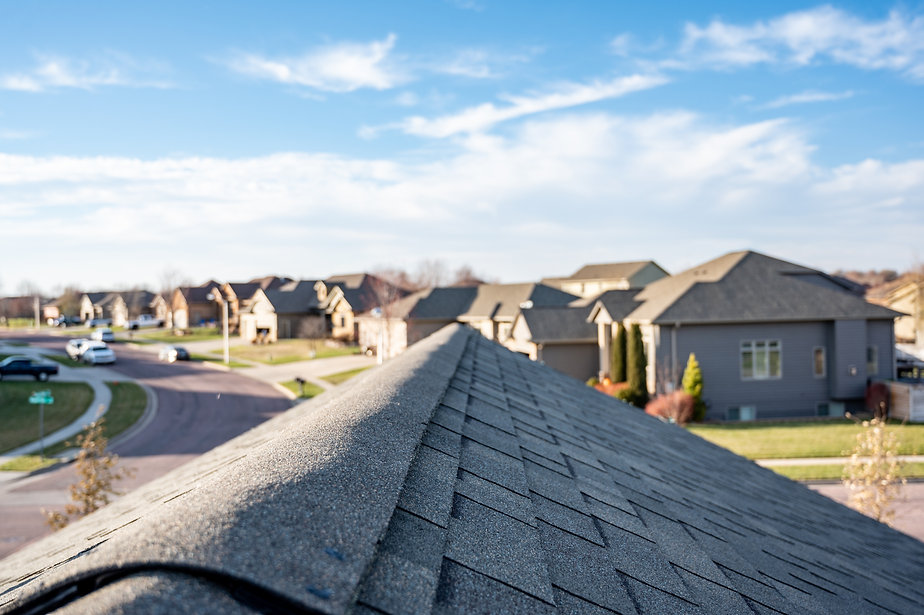 Typical residentail ridge cap on a shingle roof apex.jpg