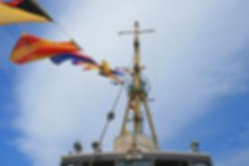 flags-on-tugboat-1731701_1920.jpg